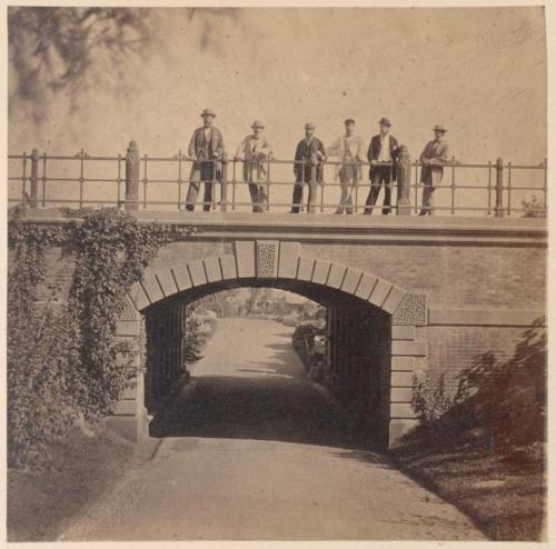 Men standing on Willowdell Arch. (1862)