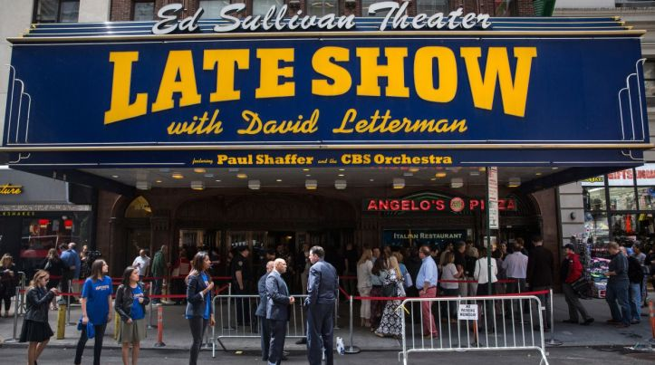 NEW YORK, NY - MAY 20:  Fans of David Letterman, members of the media, security agents, passersby and employees of the Late Show gather around the entrance to the Ed Sullivan Theater, where The Late Show with David Letterman is filmed, on May 20, 2015 in New York City. Tonight is the final show with David Letterman as the host. Stephen Colbert is slated to take over the show later this year.  (Photo by Andrew Burton/Getty Images)